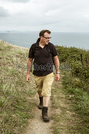 a man in walking boots with