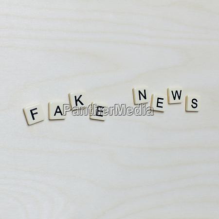 letter blocks spelling fake news
