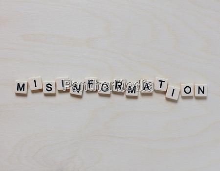 letter blocks spelling misinformation