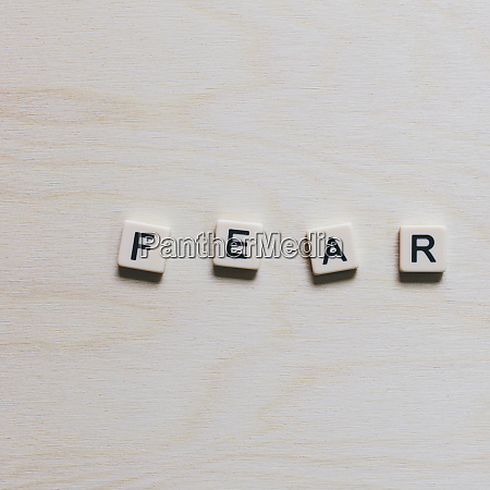 letter blocks spelling the word fear