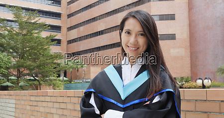 asian woman get graduation gown