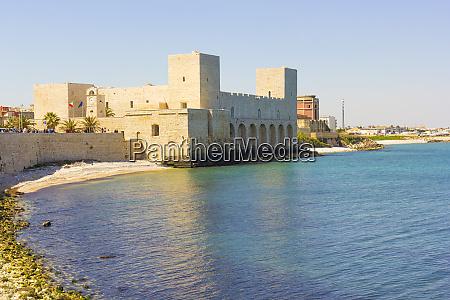the trani castle on the sea