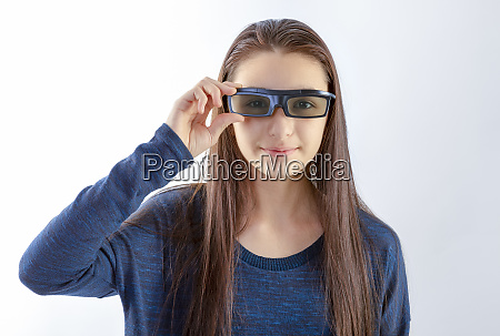 teenager girl with 3d glasses looking