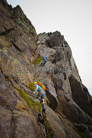 climbers ascend a gully to gain