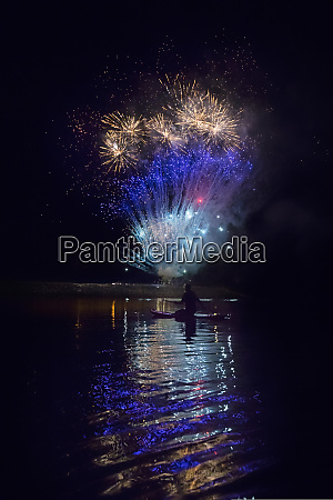 fireworks go off in background with