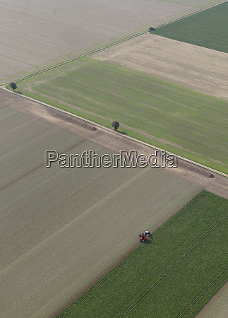 aerial view tractor in sunny agricultural