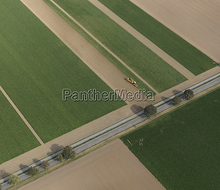 aerial view combine harvester in agricultural