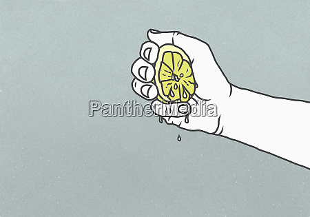 man squeezing juicy lemon