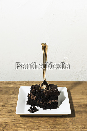 spoon in piece of chocolate cake