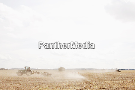 tractor plowing sunny agricultural field wiendorf