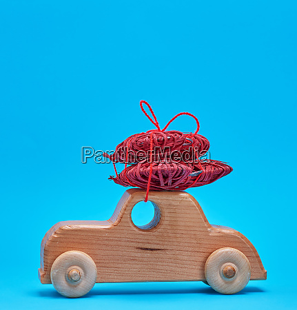 small wooden childrens car carries a