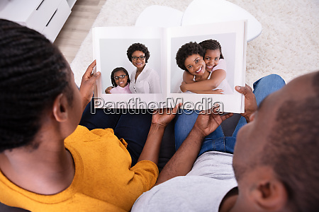 couple looking at mother and daughters