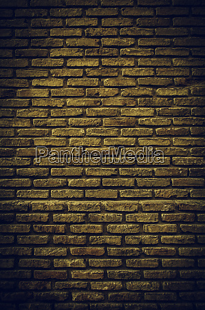 fund damaged brick wall