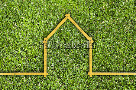 yellow meter ruler folded as house
