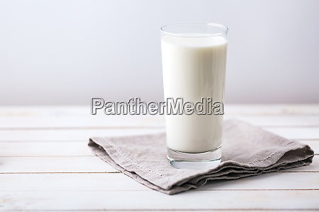 glass of milk on white rustic