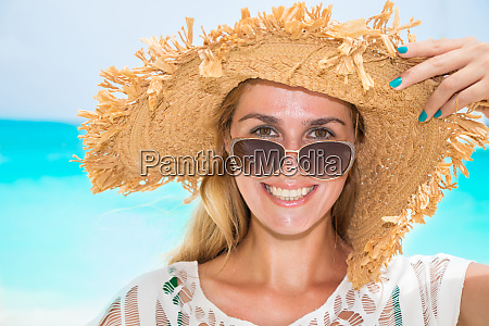 gorgeous woman with sun hat on