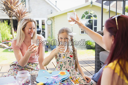 lesbian couple and daughter drinking on