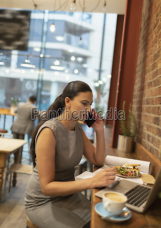 businesswoman talking on smart phone working