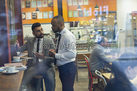 businessmen using laptop working in cafe