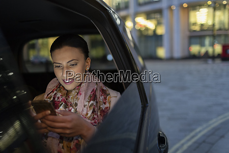 businesswoman using smart phone in crowdsourced