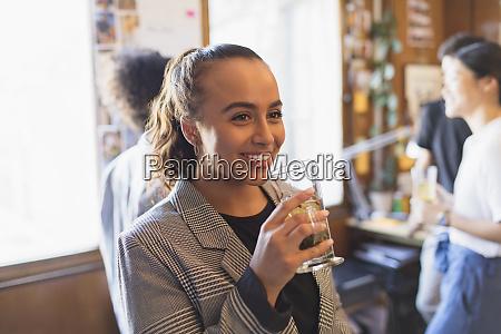 portrait smiling businesswoman drinking tea in