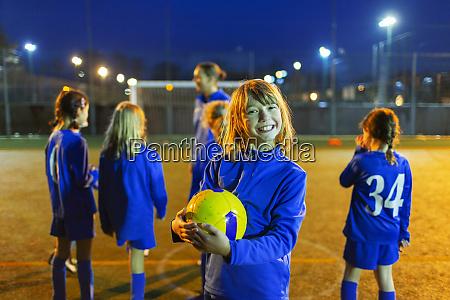 portrait smiling enthusiastic girl enjoying soccer