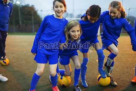 portrait happy girls soccer team on