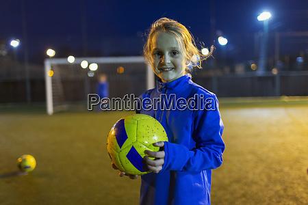 portrait confident girl soccer player on