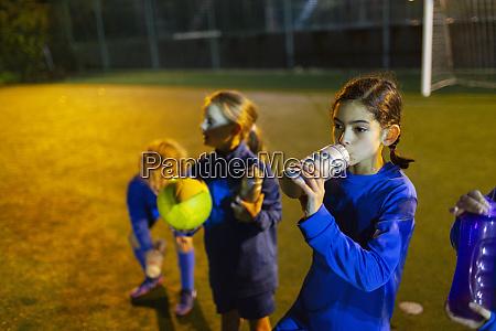 girl soccer player taking a break