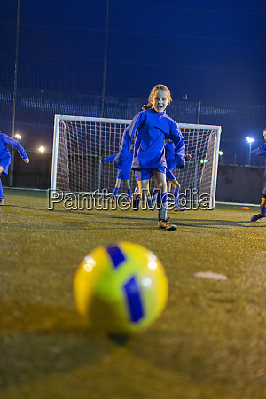 girl soccer player practicing on field