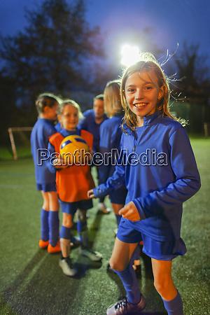 portrait smiling confident girl soccer player