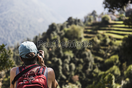 female hiker looking at view supi