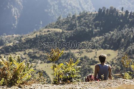 female hiker resting enjoying sunny scenic