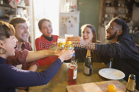 young adult friends toasting cocktails at