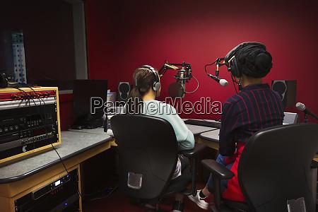 teenage girl musicians recording music singing