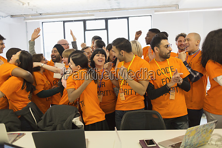 happy hackers celebrating coding for charity