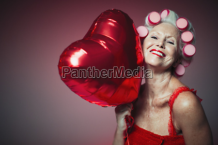 portrait playful senior woman with hair