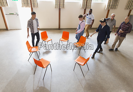 men arriving at group therapy sitting