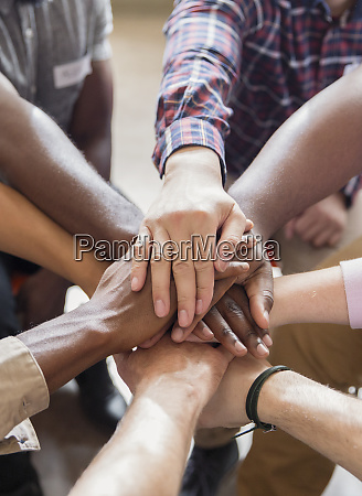 men joining hands in group therapy
