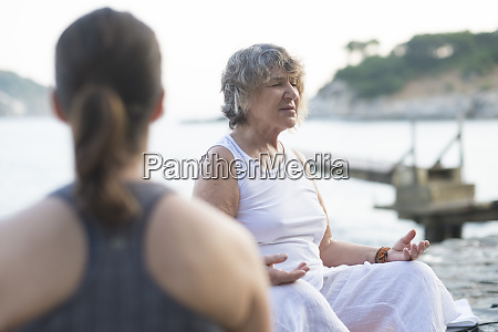 senior woman doing a yoga exercise