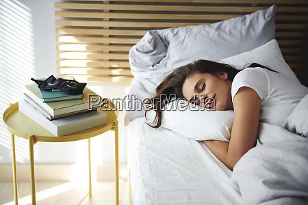 portrait of woman sleeping in bed