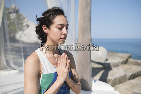 woman doing a yoga exercise at