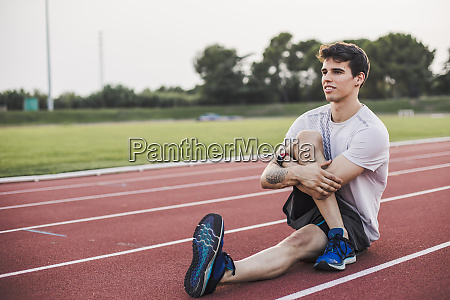 athlete doing warm up exercises on