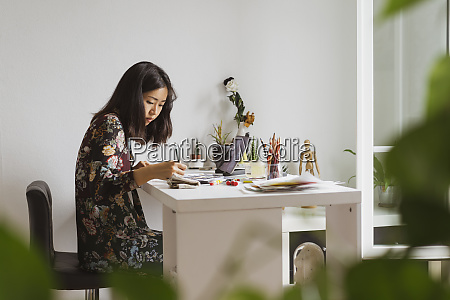illustrator sitting at work desk in