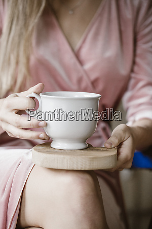 womans hands holding wooden board with