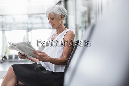 senior woman sitting in waiting area