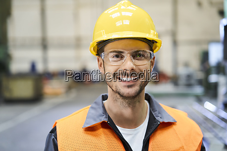 portrait of smiling man wearing protective