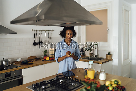 woman in her kitchen in the