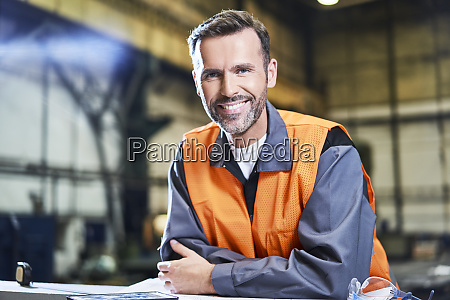 portrait of smiling man in factory