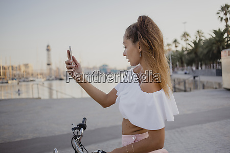 fashionable young woman exploring barcelona with